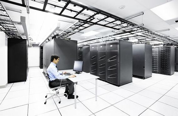 USA     Businessman working inside a server room.     Image by © Ocean/Corbis
